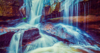 Радужные струи: водопад Хукоу превратился в ледяную сказку