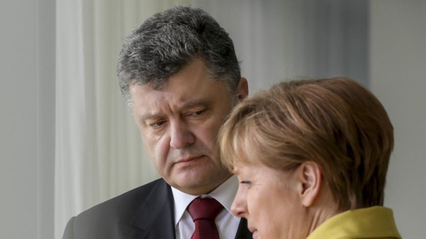 Порошенко и Меркель обсудили поставку гумпомощи в Донбасс