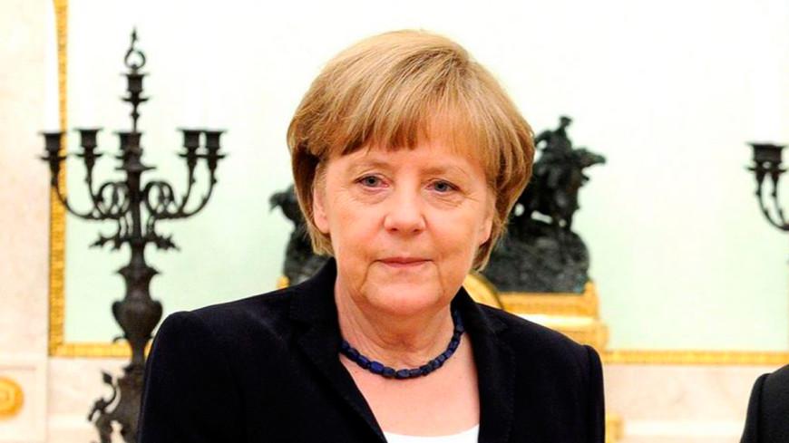 Меркель и Олланд обсудили, что будут делать с мигрантами