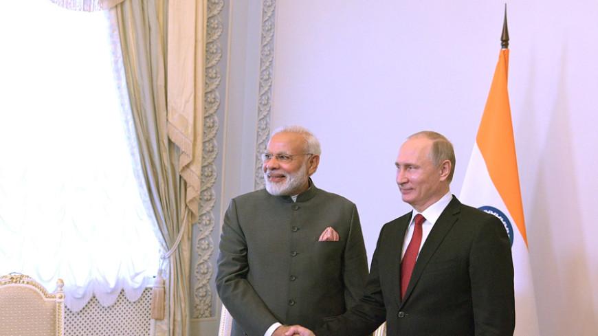 ПМЭФ: Путин поблагодарил Моди за посещение могилы его брата