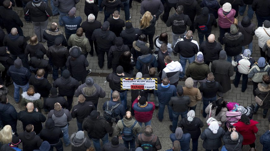 «Они приехали»: Глава МВД Германии признал беженцев террористами