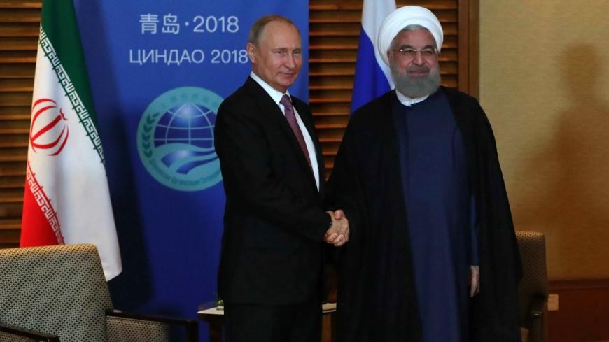 Рухани поблагодарил Путина за поддержку присоединения Ирана к ШОС