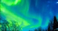 Северное чудо: сверкающие всполохи раскрасили финское небо