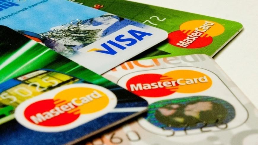 "Фото: Елена Андреева, ""«Мир24»"":http://mir24.tv/, мастеркард, карты, виза, пластиковые карты"