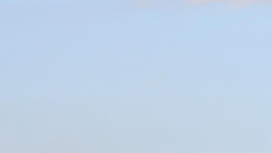 В Грозном канатоходец прошел без страховки между небоскребами