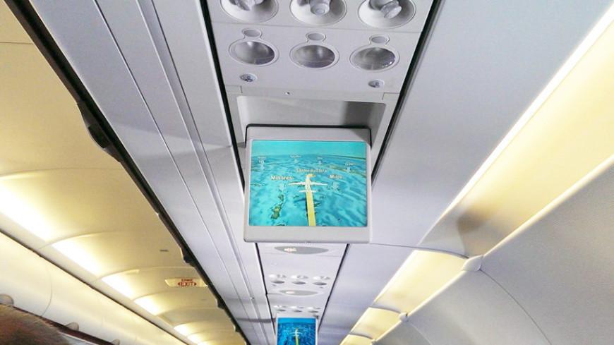 """Фото: Елизавета Шагалова, """"«МИР 24»"""":http://mir24.tv/, туристы, самолет, салон самолета, полет, перелет, рейс"""