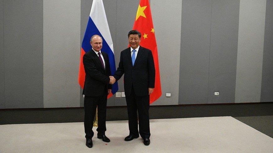 Путин поздравил Си Цзиньпина с Днем образования КНР