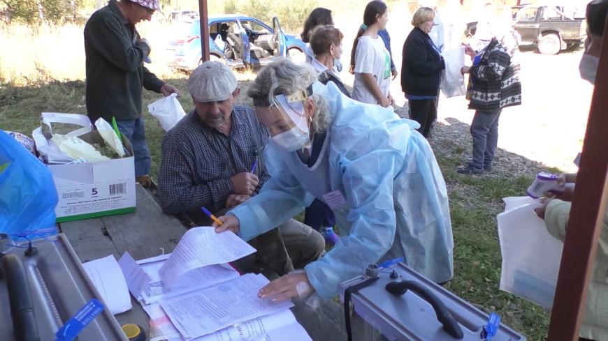 На выборы с музыкой и флагами: как прошло досрочное голосование в Кузбассе